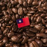 A Taiwan flag placed over roasted coffee beans.  stock photo