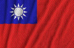 Taiwan flag printed on a polyester nylon sportswear mesh fabric. With some folds royalty free stock image