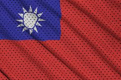Taiwan flag printed on a polyester nylon sportswear mesh fabric. With some folds stock photos