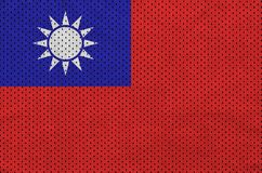 Taiwan flag printed on a polyester nylon sportswear mesh fabric. With some folds royalty free stock photo