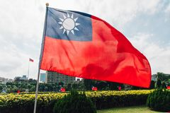 Taiwan flag waving in the wind near the area of National Dr. Sun Yat-Sen Memorial Hall in Taipei, Taiwan.  royalty free stock image