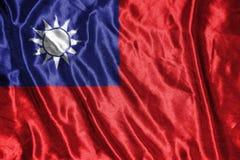 Taiwan flagga flagga på bakgrund Arkivfoto