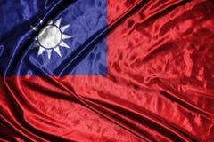 Taiwan flagga flagga på bakgrund Royaltyfri Foto