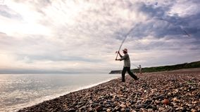 Fisherman casts his fishing rod at Qixingtan Beach in Hualien, Taiwan royalty free stock images