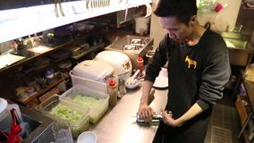 preparing Mexican food, making burritos in the kitchen of Mexican restaurant stock footage
