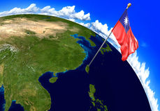 Taiwan national flag marking the country location on world map Stock Image