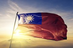 Taiwan national flag textile cloth fabric waving on the top. Taiwanese national flag textile cloth fabric waving on the top sunrise mist fog royalty free stock photos