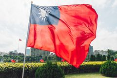 Taiwan national flag waving in the wind near the area of National Dr. Sun Yat-Sen Memorial Hall in Taipei, Taiwan.  stock photos