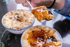 Taiwan`s distinctive famous snacks: Savory rice pudding Wa gui in a white bowl on stone table, Taiwan Delicacies stock images