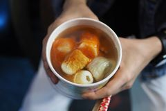 Taiwan street food in cup. Taiwan street food. Boil food sausage, fish ball and vegetable in soup stock image