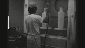 Workers Glazing Ceramics. TAIWAN, TAIPEI, APRIL 1978. Two Shot Sequence In A Pottery Workshop In The Ceramic Capital Of Taiwan, The Yingge District, With Two stock video