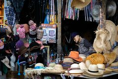 Tired old man sleeps at his stall in Taiwan royalty free stock photography