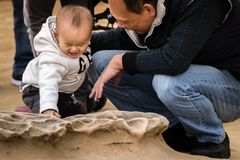 TAIWAN, TAIPEI, YEHLIU GEOPARK - JANUARY 2014: An unidentified pair of father and child spends a day at the famous Yehliu geo park stock image