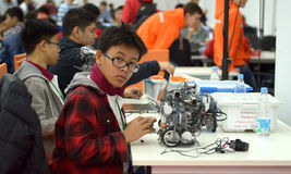 Taiwan teens make a robot at the robot Olympiad Stock Images