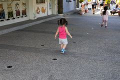 In the kindergarten, the children play the game on the floor stock image
