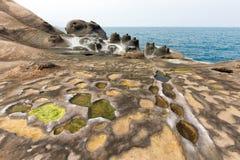 Taiwan Yehliu geologic rock formation. Amazing geologic natural sandstone formation at the Yehliu geopark, Taiwan Royalty Free Stock Image