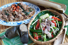 Taiwanese aborigine gourmet. Aborigine gourmet of Atayal Tribe in Taiwan.The left is fried sliced boar.The right is preserved sliced boar, and the left corner is Stock Photography