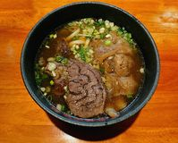 Taiwanese Beef Noodles. On wooden table royalty free stock image