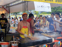 Taiwanese businessmen grilling  skewers Stock Photo