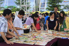Taiwanese businessmen selling  books Royalty Free Stock Photo
