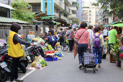 Taiwanese buy food at alley vegetable stalls Royalty Free Stock Image