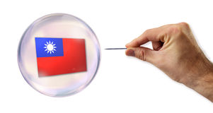 Taiwanese economic Bubble about to explode by a needle. Picture of Taiwanese economic Bubble about to explode by a needle Stock Images