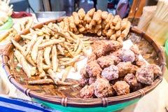 Taiwanese fried crispy sweet potato fries and deep fried popcorn chicken Stock Image