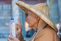 Taiwanese monk at the Wenwu temple blessing a bottle of water Royalty Free Stock Images