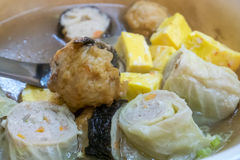 Taiwanese oden meat balls in soup at food street night market. The close up of Taiwanese oden meat balls in soup at food street night market in Taipei, Taiwan Stock Image