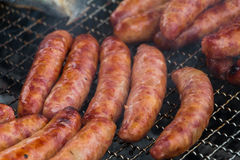 Taiwanese sausages on the grill Royalty Free Stock Images