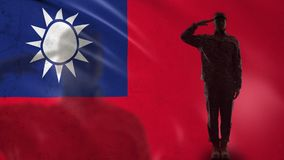 Taiwanese soldier silhouette saluting against national flag, border forces. Stock footage stock footage