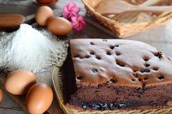 Taiwanese sponge cake. Taiwanese  chocolate sponge cake with bambo mat on wooden board Royalty Free Stock Image