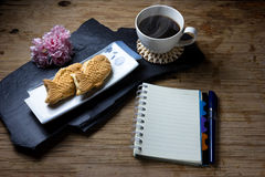 Taiyaki cakes, coffee,notebook on wood background Royalty Free Stock Images