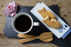 Taiyaki cakes with coffee on wood background Royalty Free Stock Photos