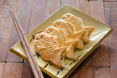 Taiyaki cakes on wood background,Japanese confectionery Royalty Free Stock Images