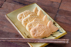 Taiyaki cakes on wood background,Japanese confectionery Stock Photography