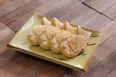 Taiyaki cakes on wood background,Japanese confectionery Stock Photos