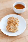 Taiyaki fish cake with cup of tea Royalty Free Stock Photography