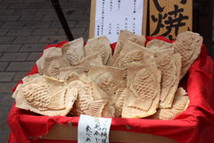 Taiyaki Japanese fish-shaped cake. Taiyaki is a Japanese fish-shaped cake. The most common filling is red bean paste that is made from sweetened azuki beans Stock Images