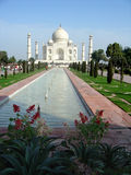 Taj Mahal. On a busy day, looking out from shade with flowers including Orchid in foreground royalty free stock photo