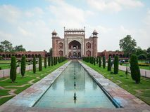 Taj Mahal in Agra, India. Agra, India - Jul 13, 2015. Gate of Taj Mahal in Agra, India. The palace was commissioned in 1632 by Shah Jahan, to house the tomb of Stock Images