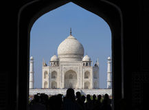 The Taj Mahal, Agra, India. Agra, India - October 11, 2016: Taj Mahal viewed through entrance gate and silhouette of people going through entry gate to the Taj Stock Images