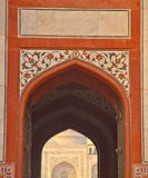 Taj Mahal from Arched Entrance of Surrounding Building Stock Photos