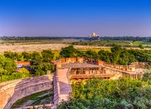 Taj Mahal behind bars - panoramic view of fields with Taj Mahal in background from Agra Red Fort. In Agra, Uttar Pradesh, India stock photos