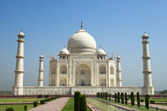 Taj Mahal Travel Agra, India, Blue Sky. A blue sky rises above the Taj Mahal in Agra, India. The mausoleum is a popular tourist attraction for people on vacation Stock Photos