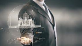 Taj Mahal Businessman che tiene le nuove tecnologie disponibile del punto di riferimento Immagine Stock