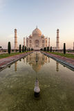 Taj Mahal. Classic view of Taj Mahal and reflection early in the morning Royalty Free Stock Photo