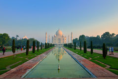 Taj Mahal at dawn, India. The Taj Mahal  crown of palaces,  is a white marble mausoleum located in Agra, Uttar Pradesh, India. It was built by Mughal emperor Royalty Free Stock Photo