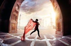 Taj Mahal dream. Woman with red scarf dancing near Taj Mahal in Agra, Uttar Pradesh, India Royalty Free Stock Images