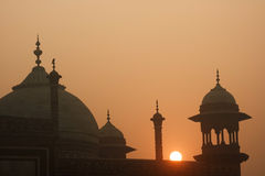 Taj Mahal with early morning sun. These are the domes and spires of the Jawab.  This mirrors the mosque on the west side of the Taj Mahal but isn't used for Royalty Free Stock Photos